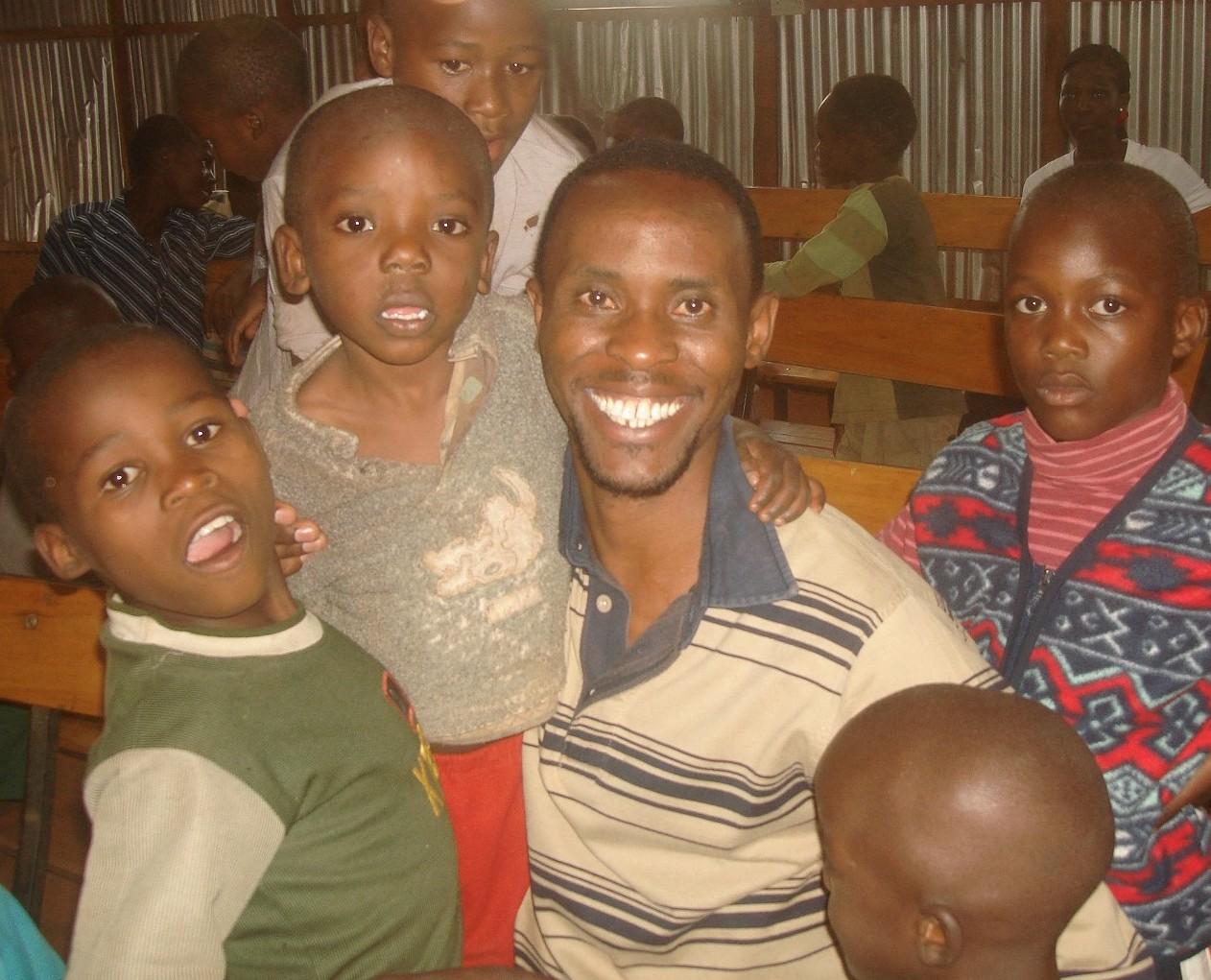 Sammy and children in the YCT Building Center