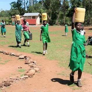 Dala Development - hauling water for cement mixing