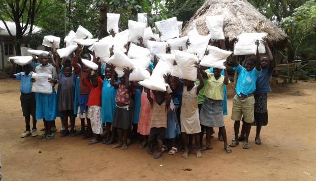 Children receive pillows.