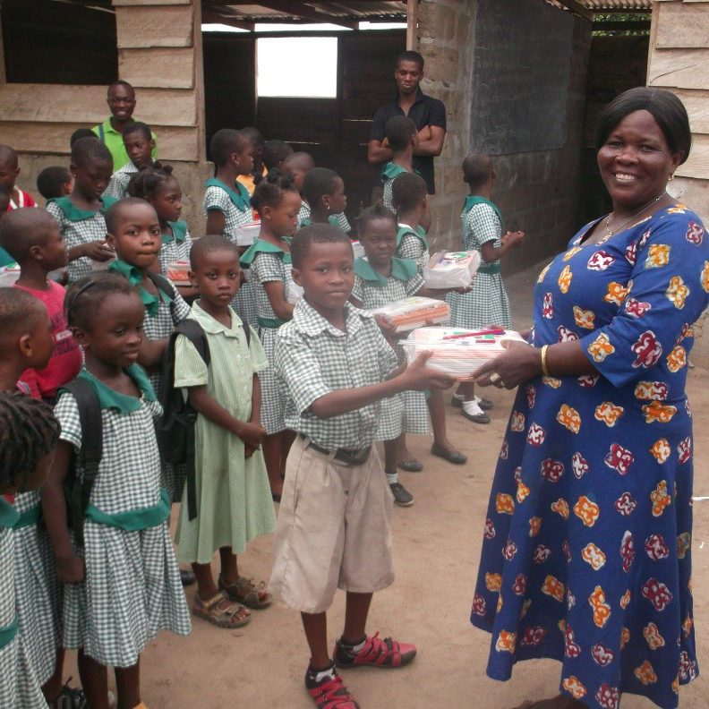 Most High Mission - children receiving exercise books