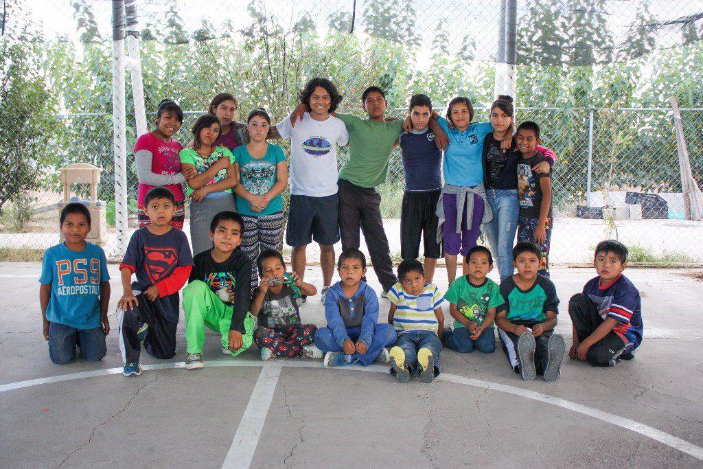 Instructor Gabriel and a group of children from Casa Hogar Adonai orphange.