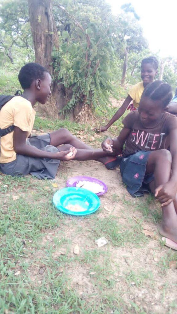 Girls sharing lunch.