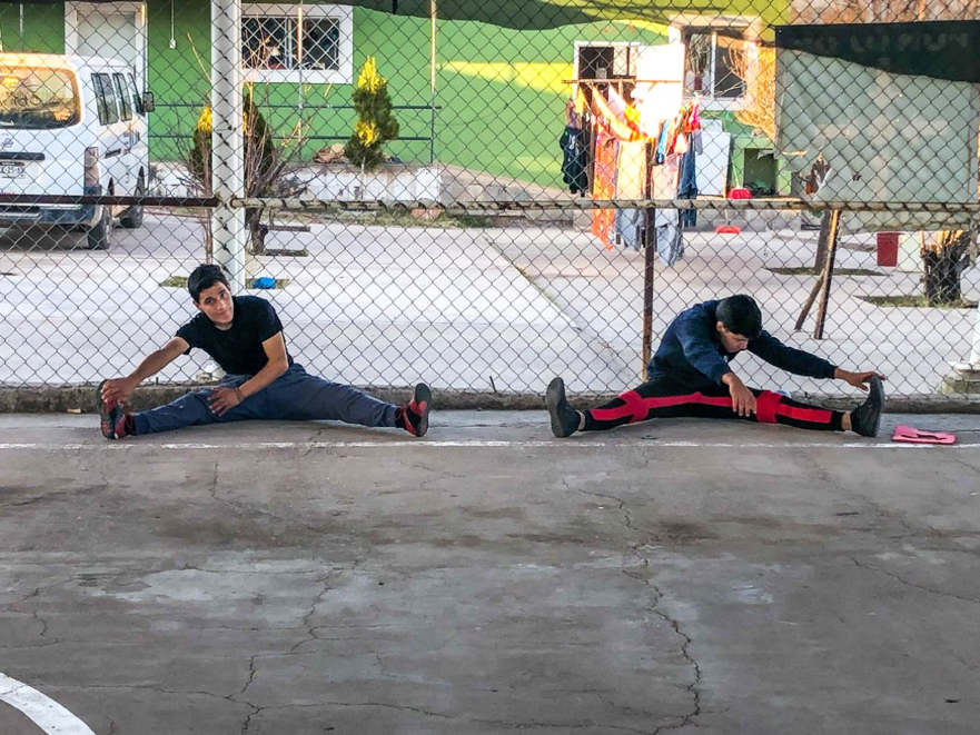 Stretching during Capoeira class.