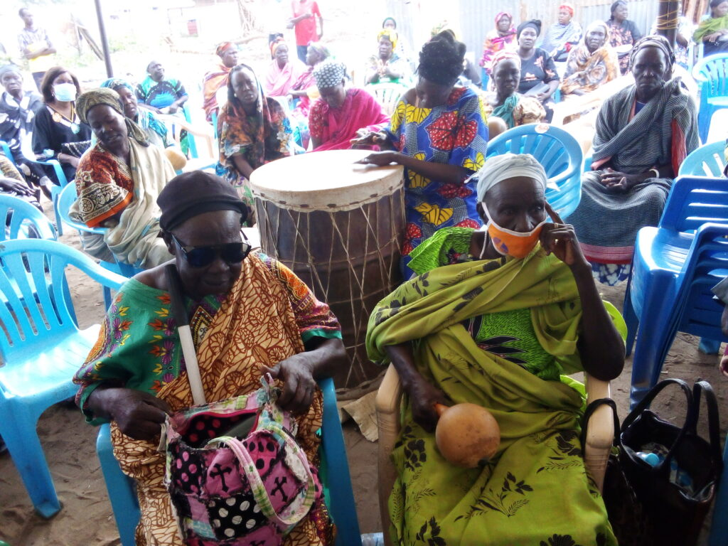 Women playing the drums for funeral service.