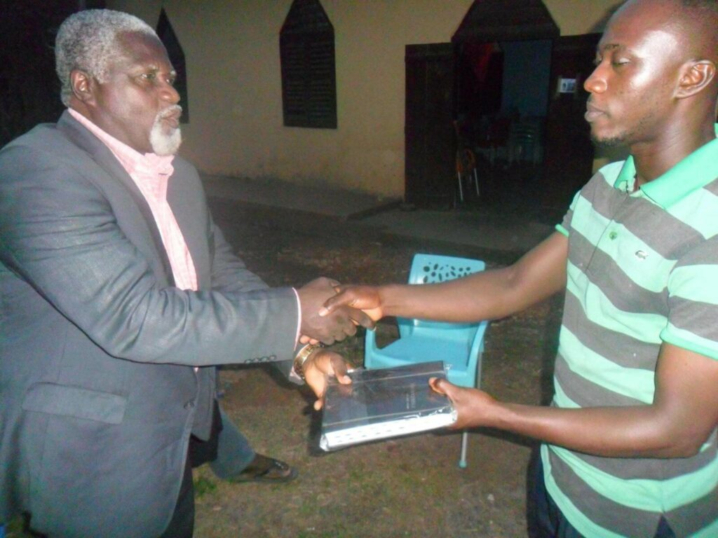 Joshua receiving a Bible for ministry.